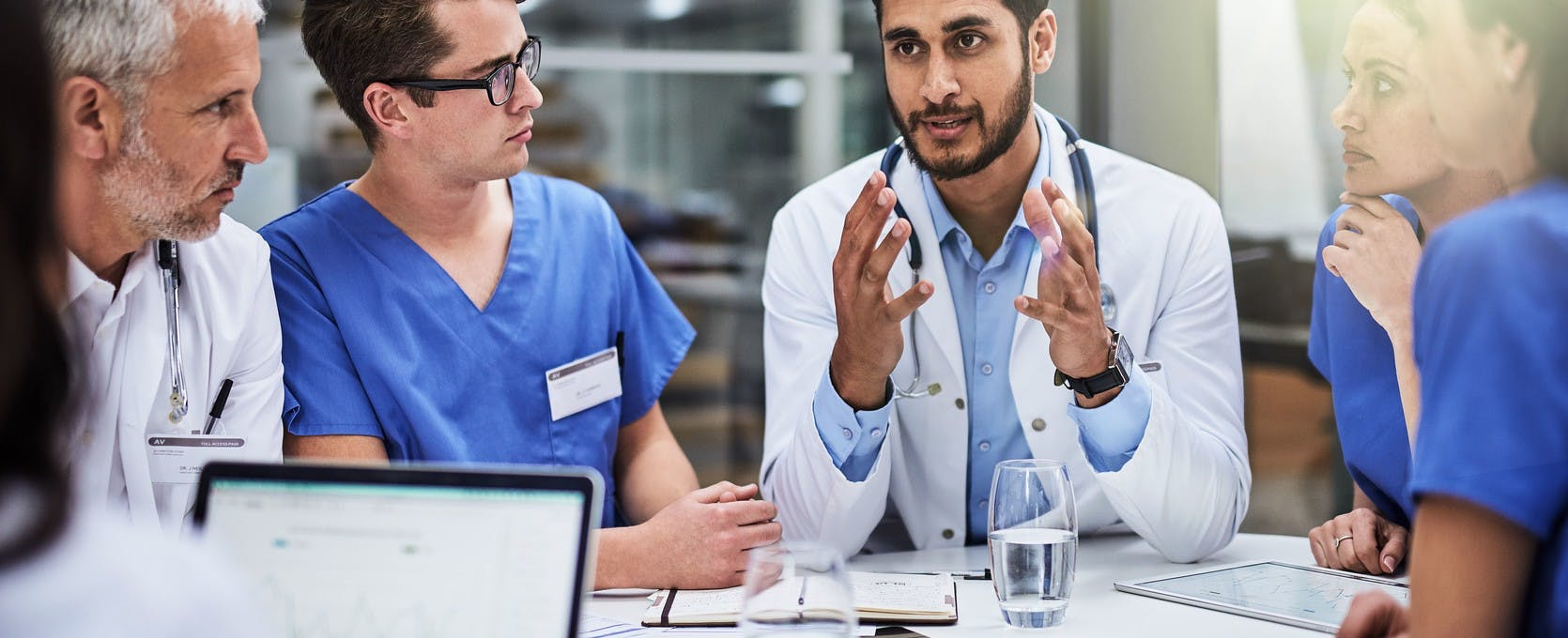 Healthcare professionals consult on patient care