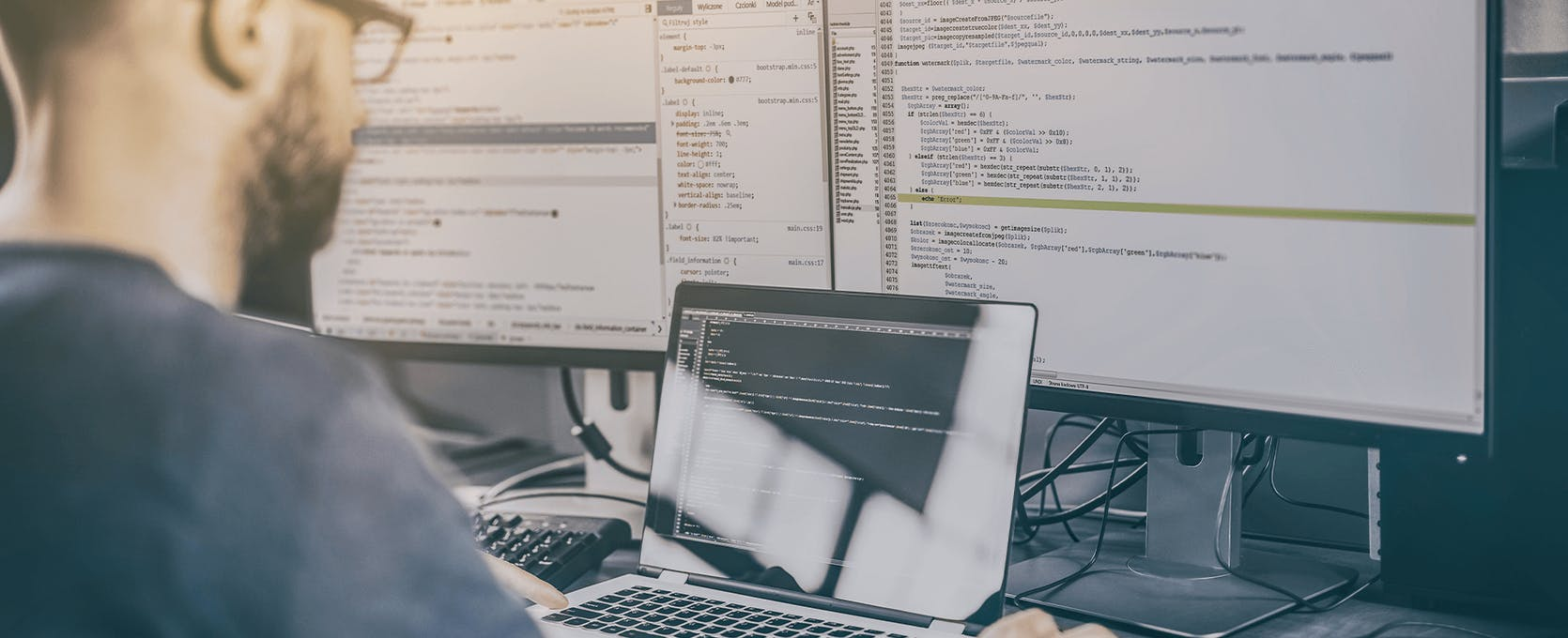 Professional software engineer analyzes data and software programs at computer