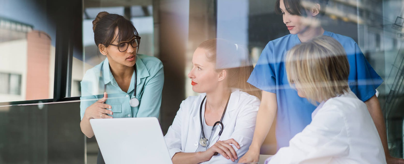 Female medical professionals meet to share healthcare information