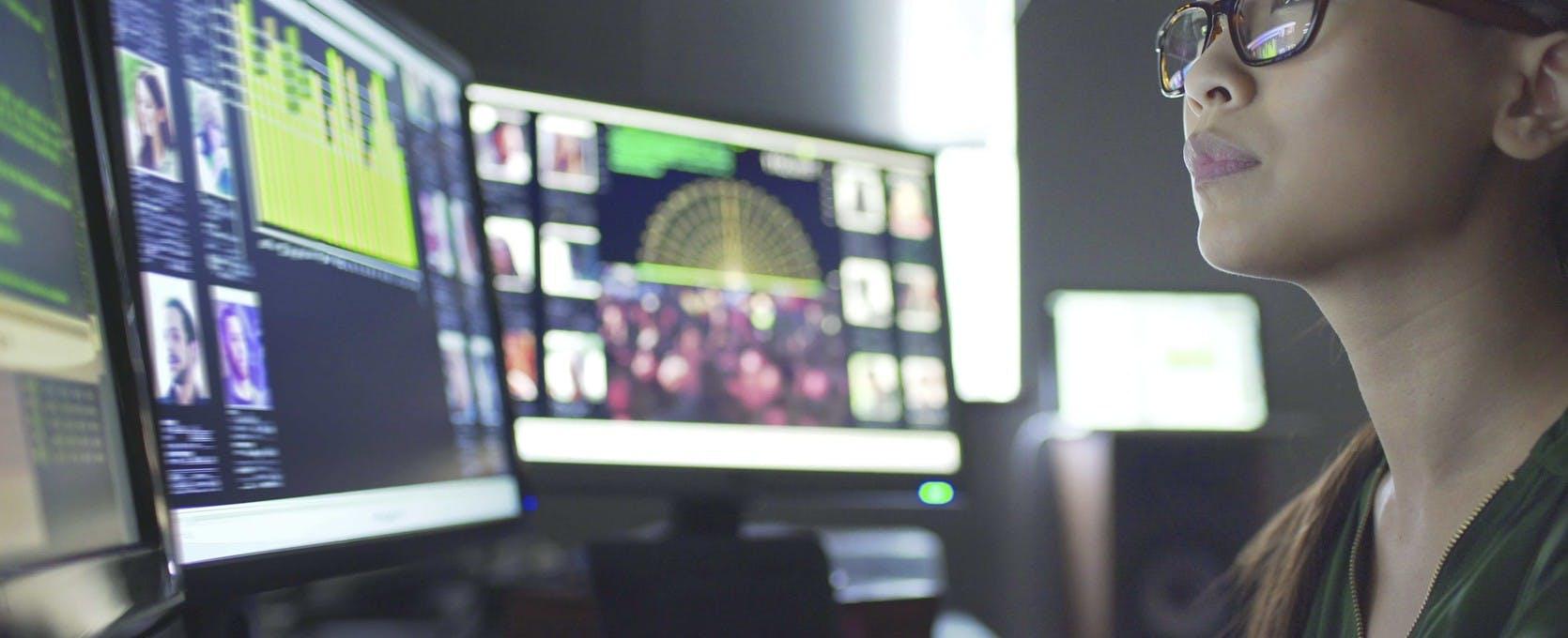 Analyst reviewing data via an insurtech system