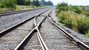 Two railroad tracks merge en route