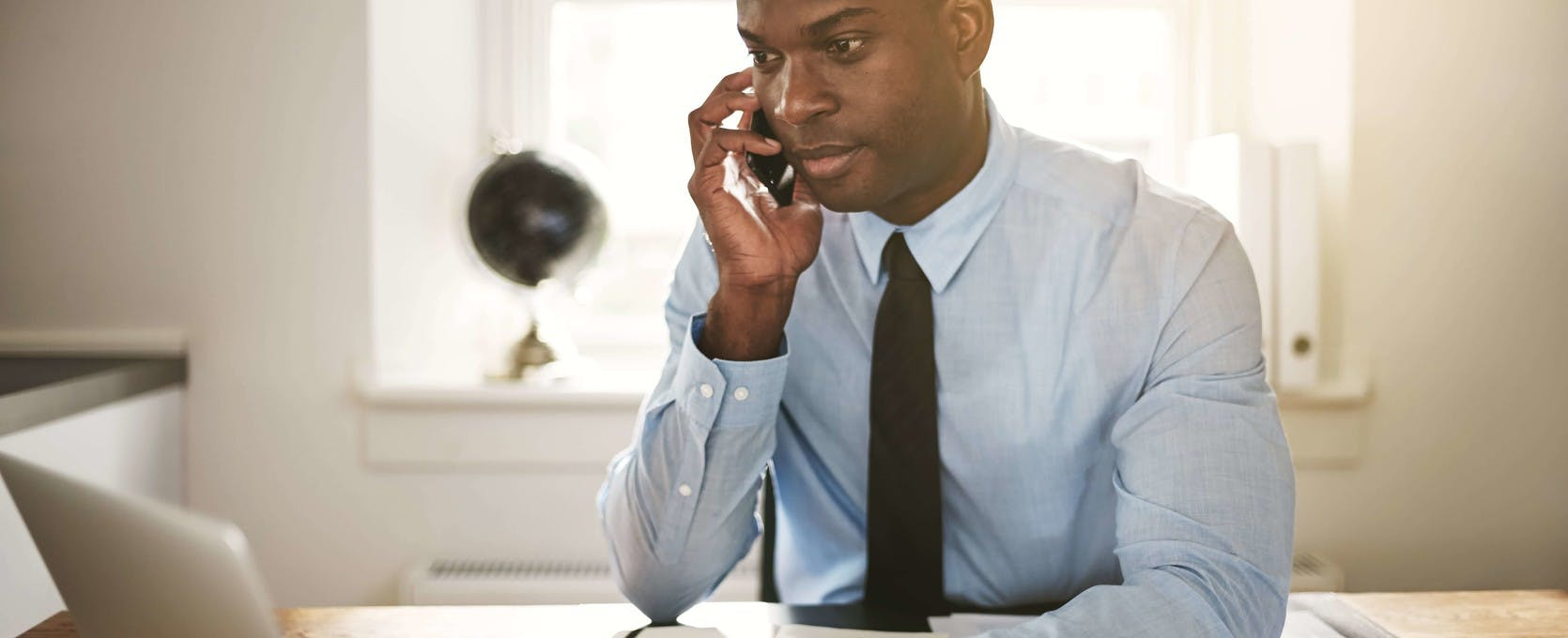 Lawyer on mobile phone in law firm office