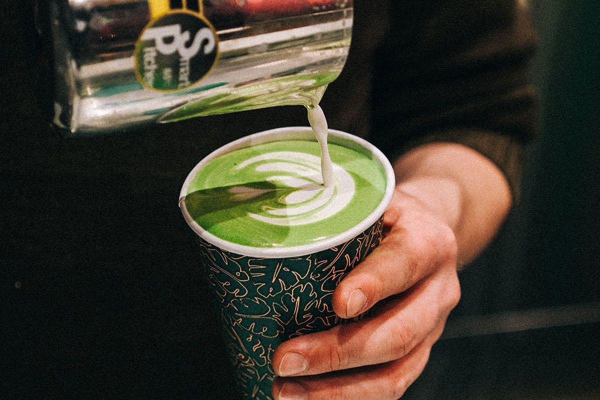 Matcha latte being poured