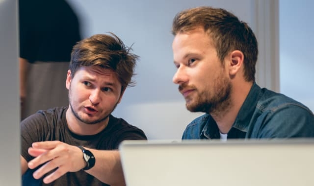 Two developers discussing about the code - Thumbnail