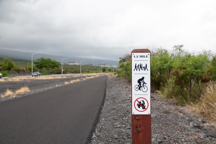 Signage showing proper usage of pedestrian and bicycle path.