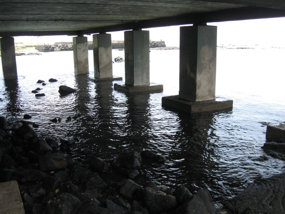 Building's pillars located within the Resort's tide pool