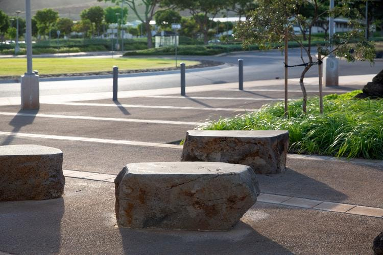 Seating made from natural boulders smoothly cut at the top.