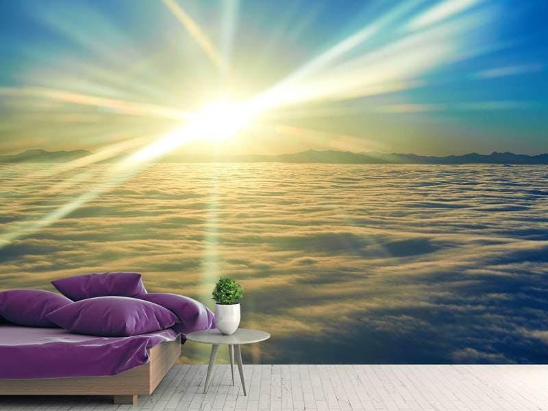 Fototapete Sonnenaufgang über den Wolken