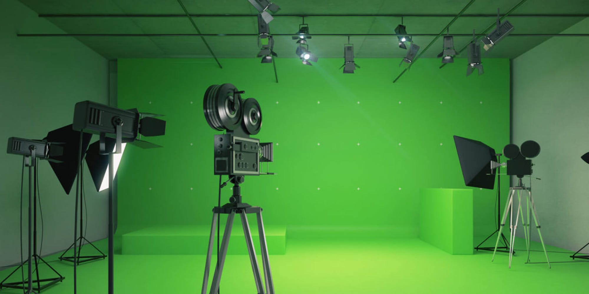 A studio filled with equipment, lights and greenscreen