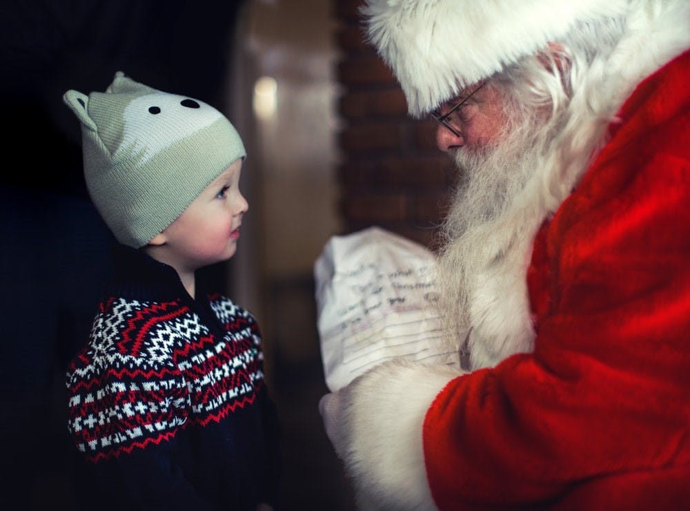Santa Claus speaking to a male toddler