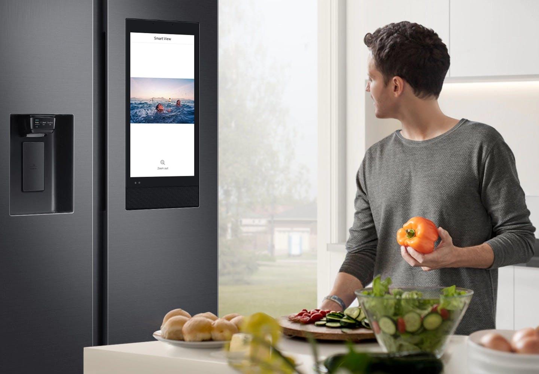 A man using a smart refrigerator