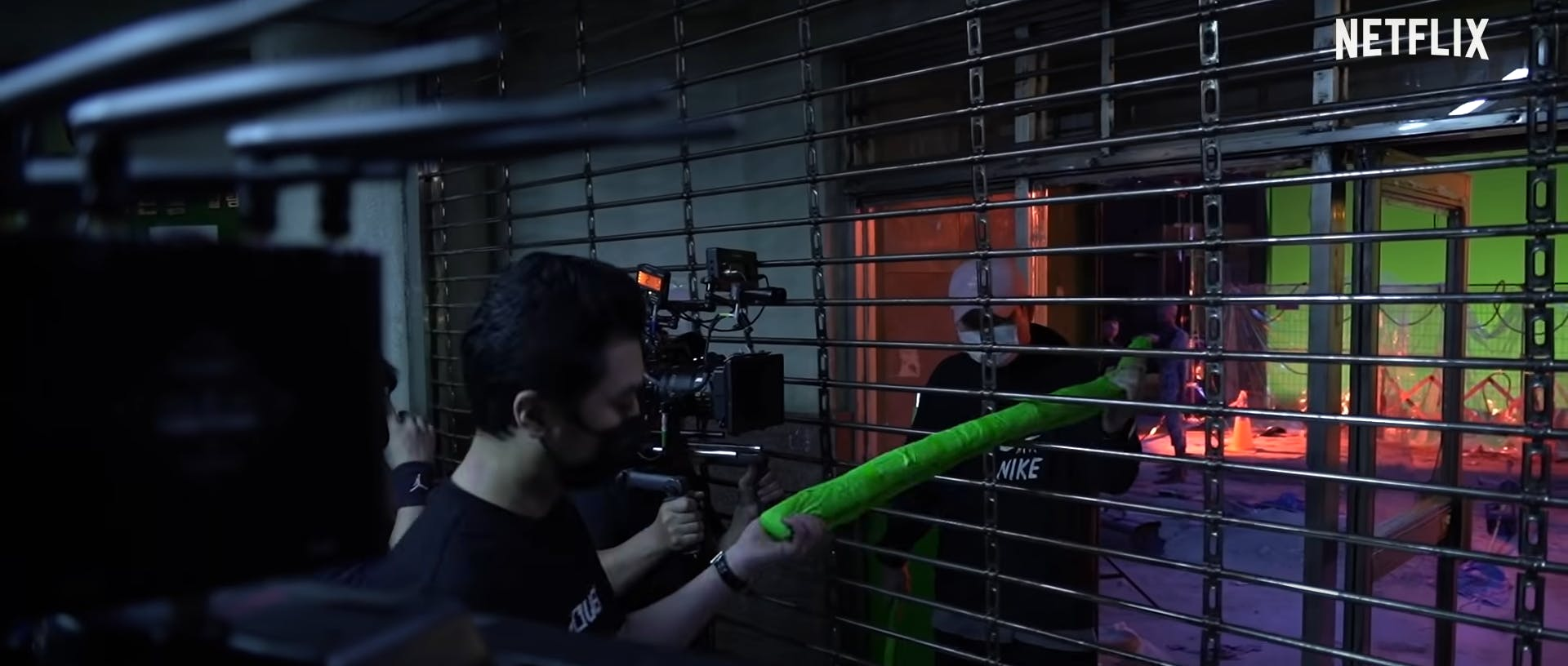 Production crew uses a green rod during the set of sweet home