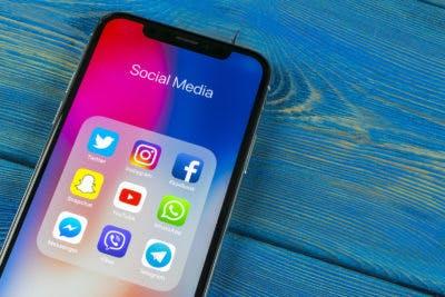 A phone showing social media platforms