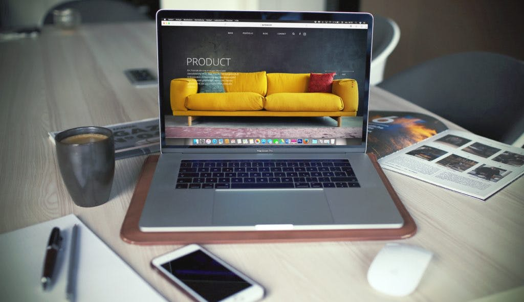 Macbook Pro focusing on a product webpage