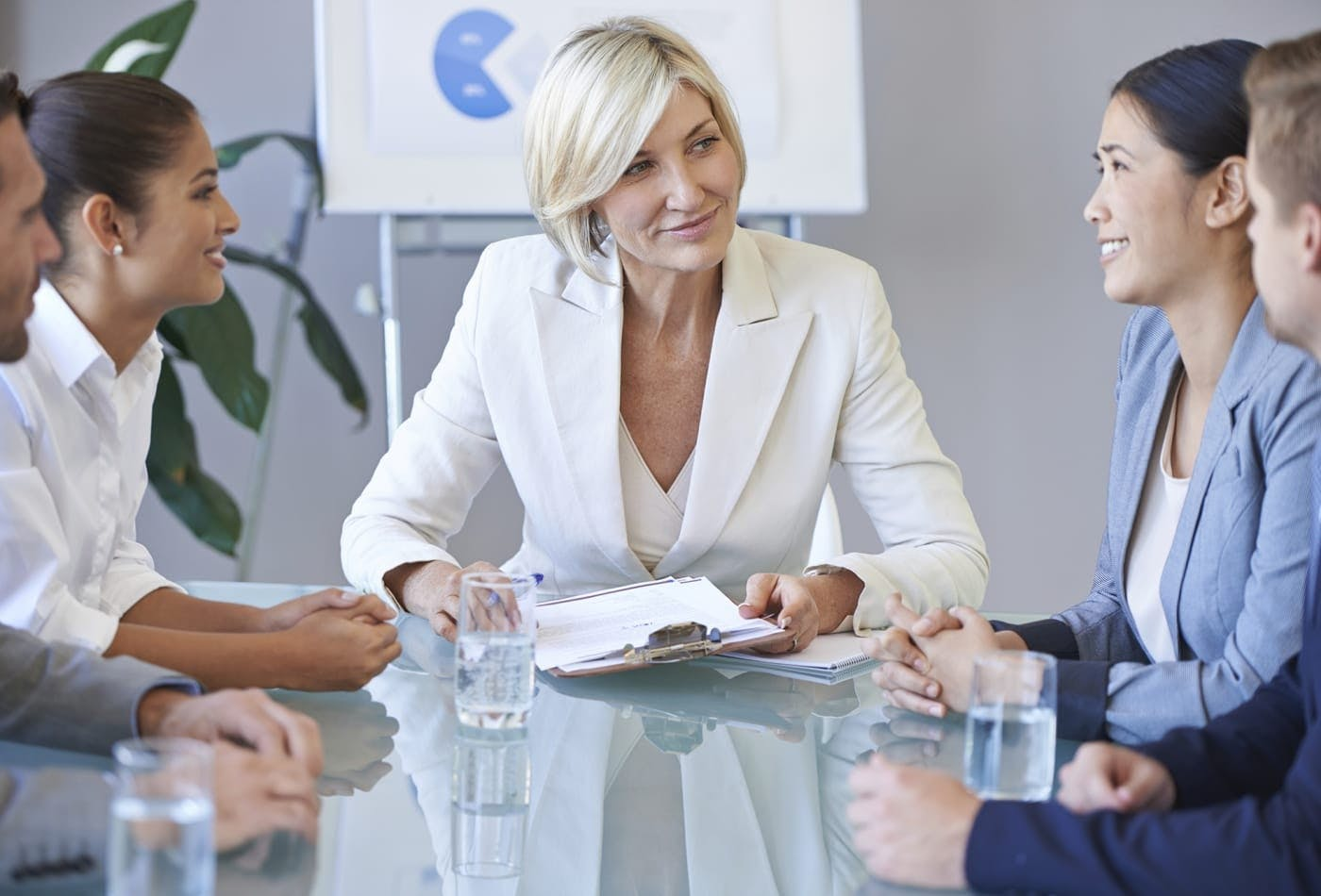 A female leading a business meeting
