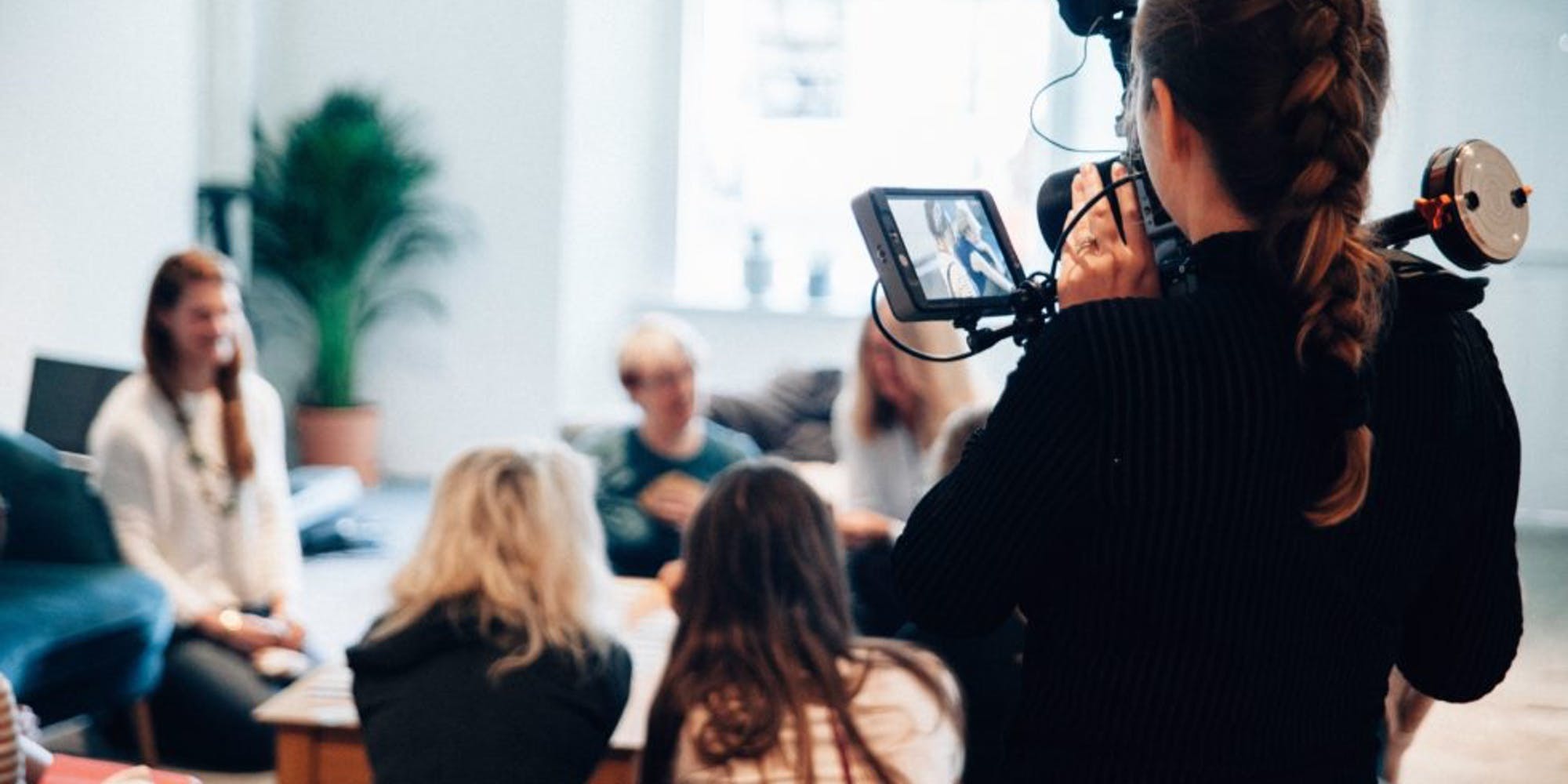 Behind the scenes of a lady recording a video of a meeting