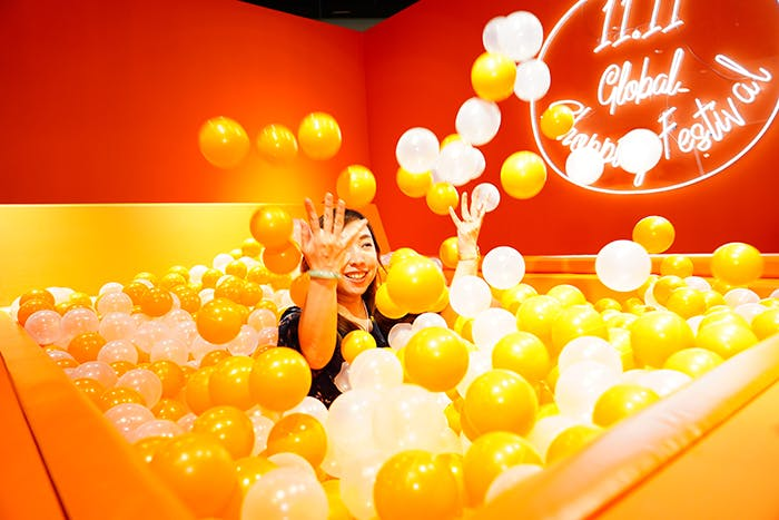 A girl in a ball pit