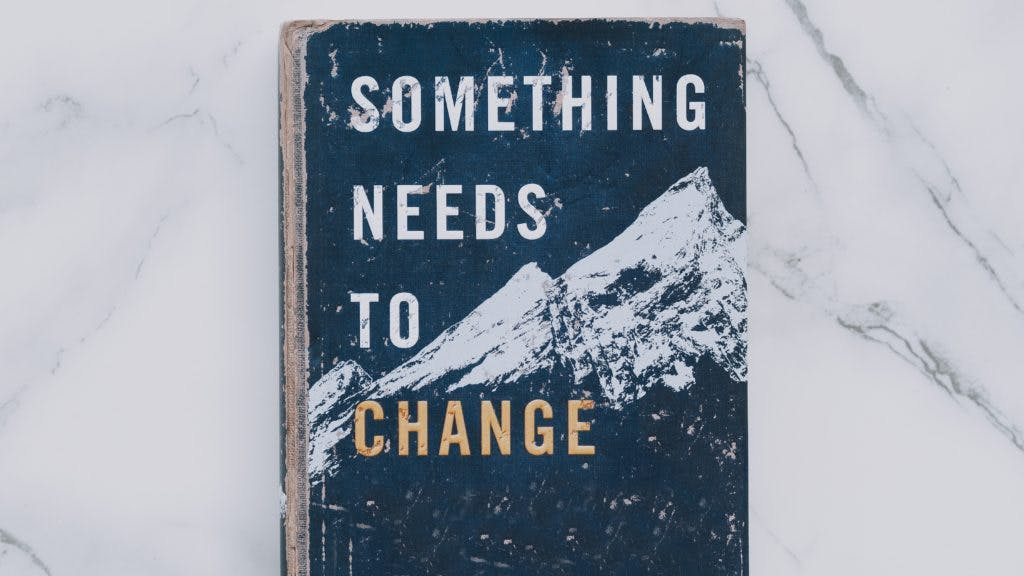 "A book titled ""Something needs to change"" on a marble table"