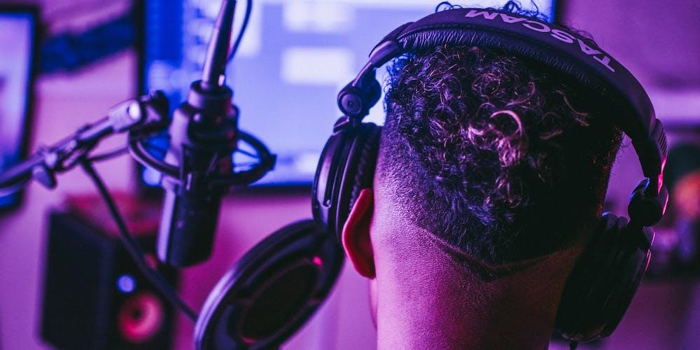 Guy in headphones recording audio