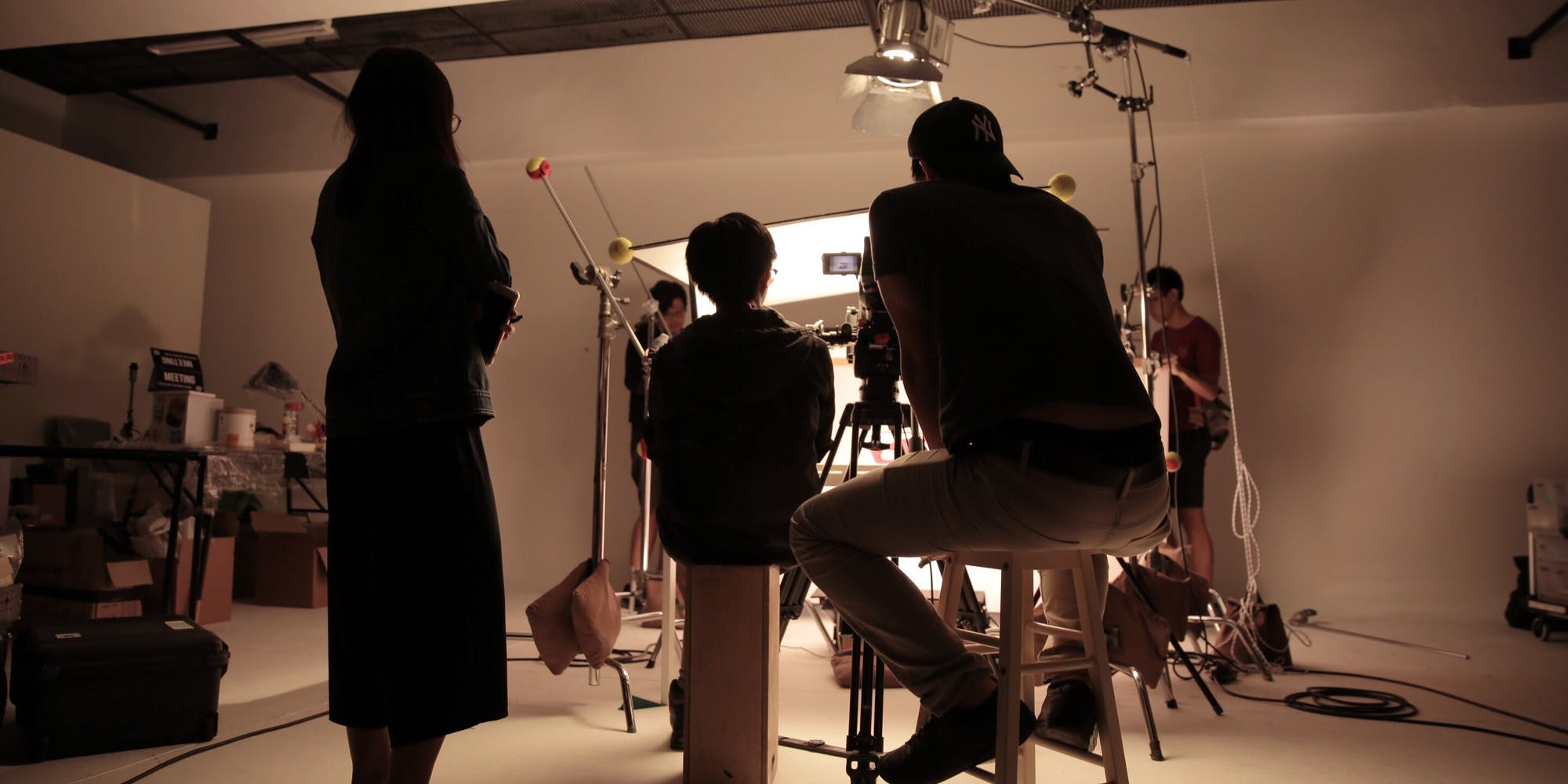 Behind the scenes of a production shoot at a studio
