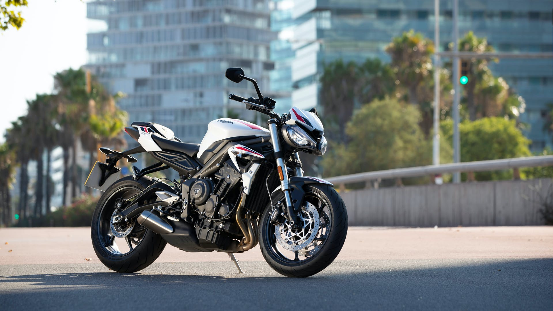 Triumph Street Triple S in crystal white colour, parked.