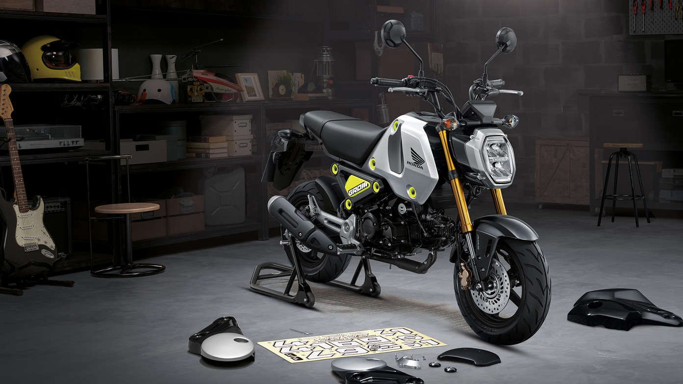 Honda GROM in force silver metallic colour, parked
