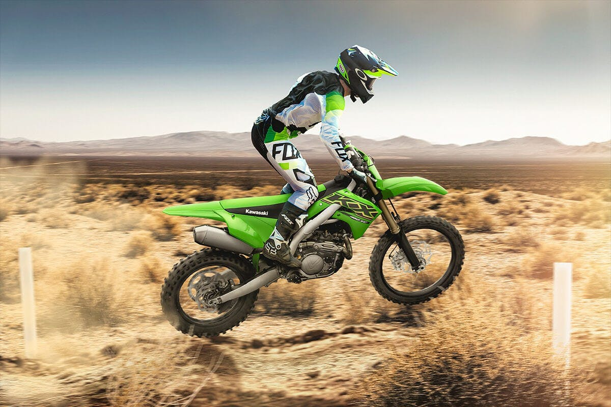 Kawasaki KX450XC in lime green colour on off road track