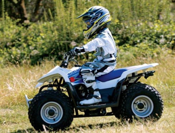 SUZUKI QUADSPORT Z50 being ridden on a farm