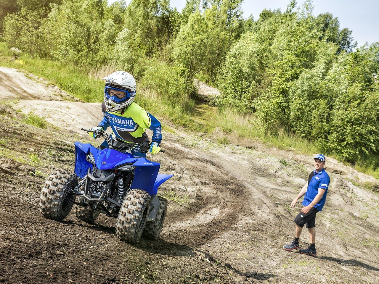Yamaha YFZ50 in team yamaha blue colour, being ridden off-track