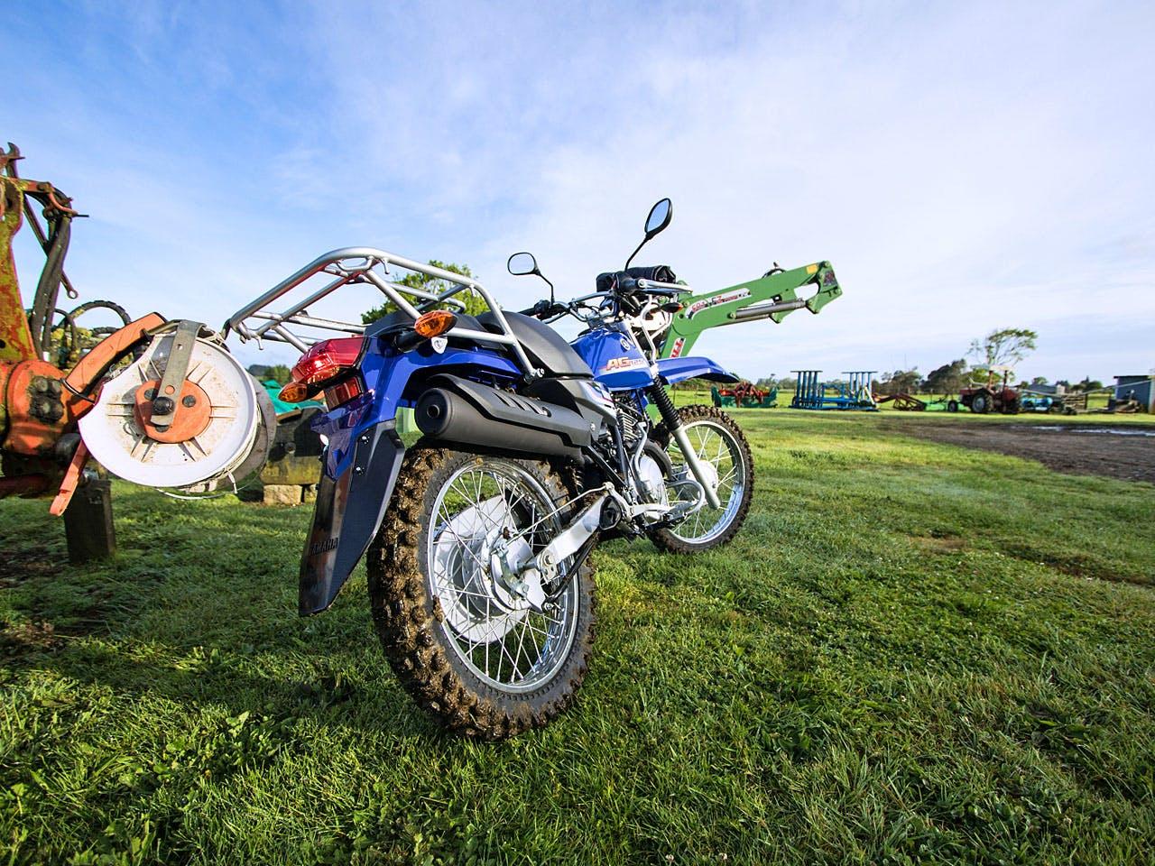 Yamaha AG125 motorcycle on a farm