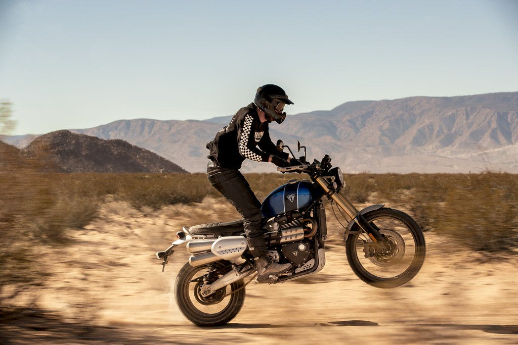 TRIUMPH SCRAMBLER 1200XE being off road on a hill