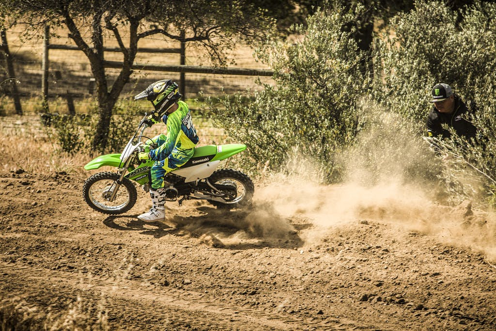 Kawasaki KLX110R in Lime Green colour on track