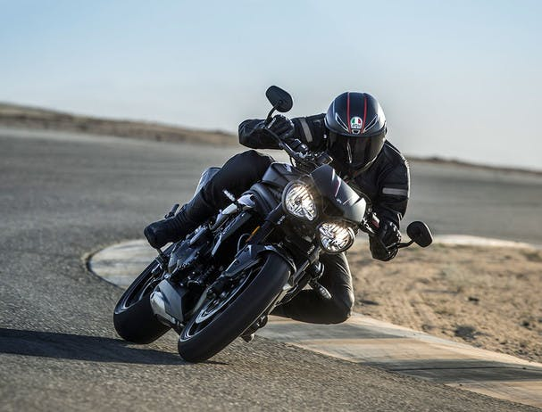 TRIUMPH SPEED TRIPLE S being ridden on the hill road