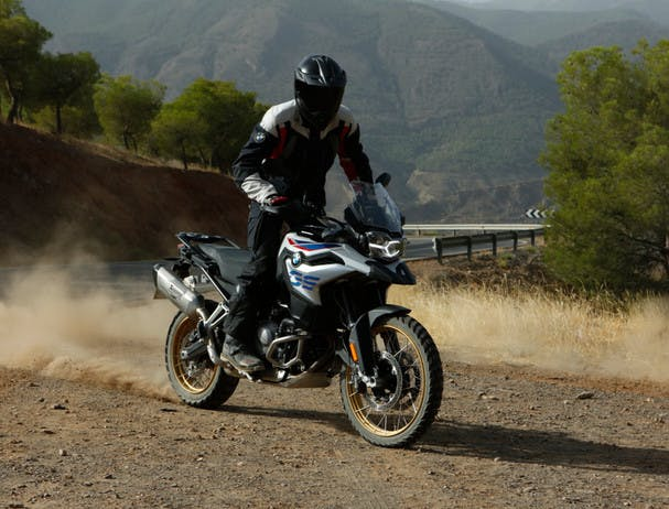 BMW F 850 GS Rallye motorcycle being ridden on a hill road