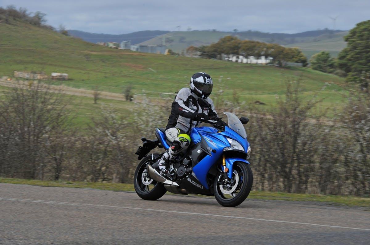 SUZUKI GSX-S1000F being ridden on a road