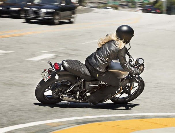 TRIUMPH STREET TWIN being ridden on the road