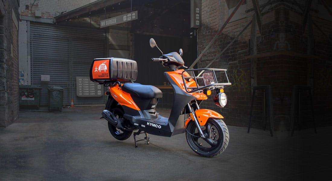 KYMCO AGILITY CARRY 125 in orange colour,parked
