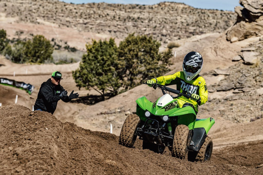 Kawasaki KFX90 in Lime Green colour in action on dirt track