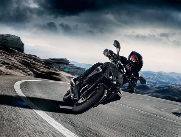 KAWASAKI Z1000 in metallic flat spark black and metallic matte graphite gray colour being ridden on a hill road