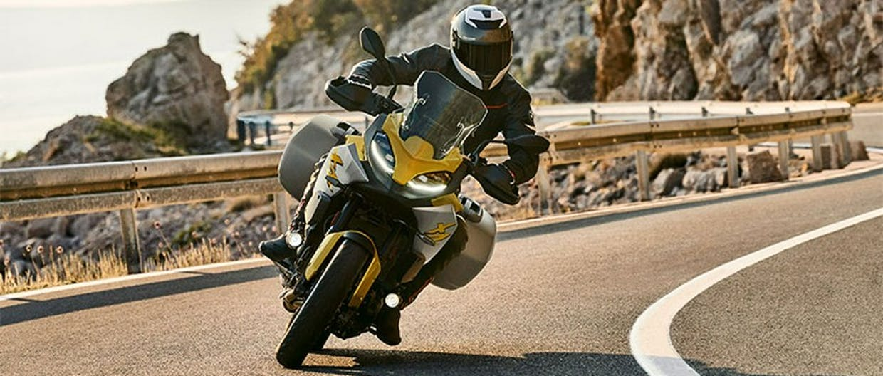 BMW F 900 XR in Exclusive Style - Galvanic Gold Metallic colour in action on the road.