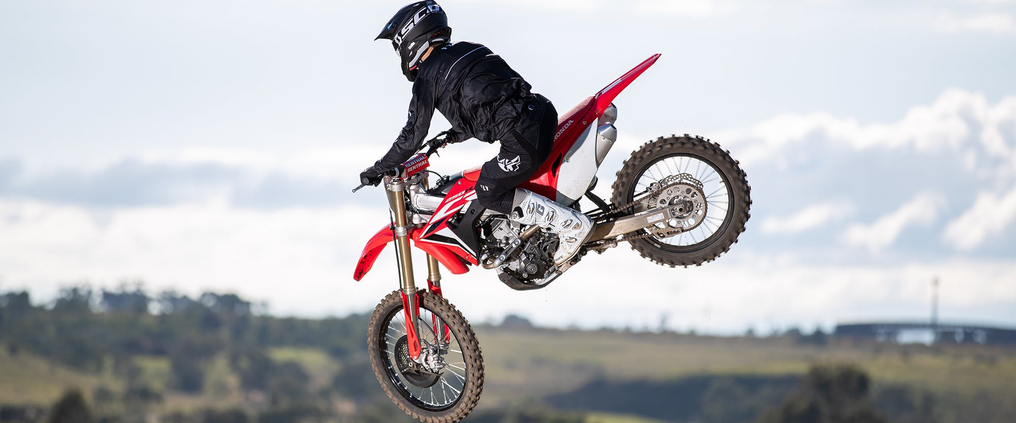 Honda CRF250R in extreme red colour doing air stunts