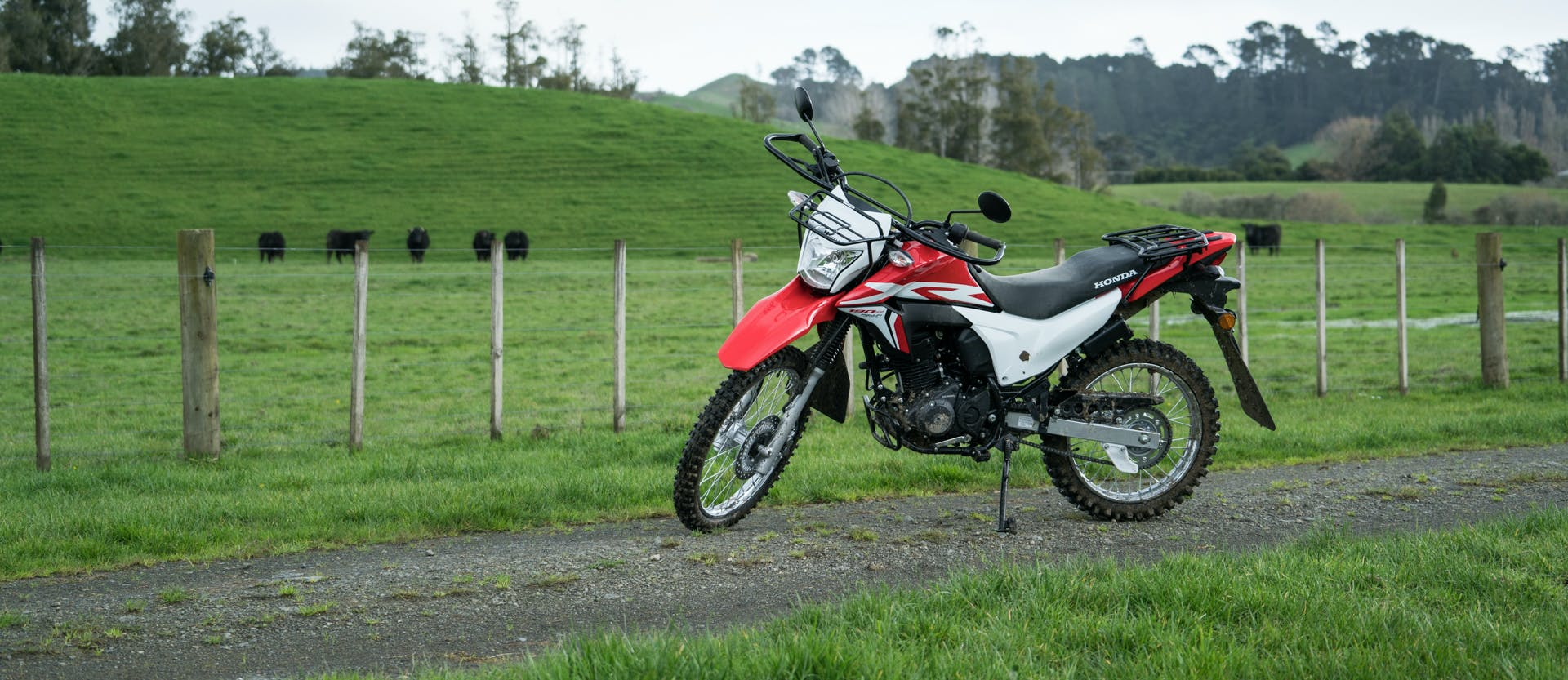 Honda XR190CT AG-XR in fighting red colour parked on the farm road