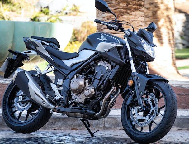 Honda CB500F in matte gunpowder black metallic colour, parked