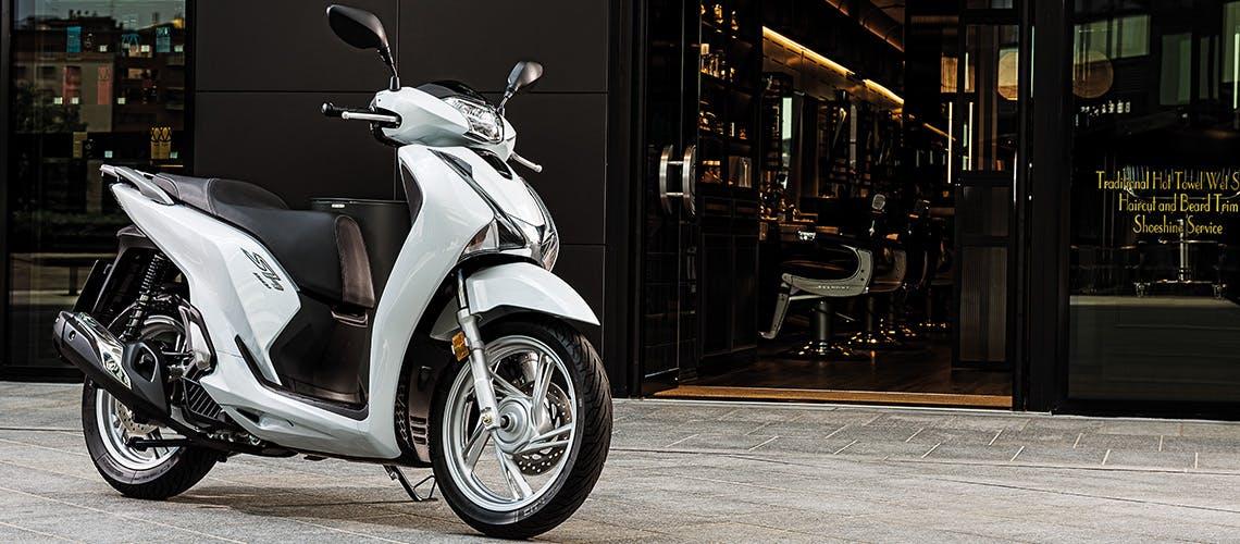 Honda SH150 pearl jasmine white colour, parked
