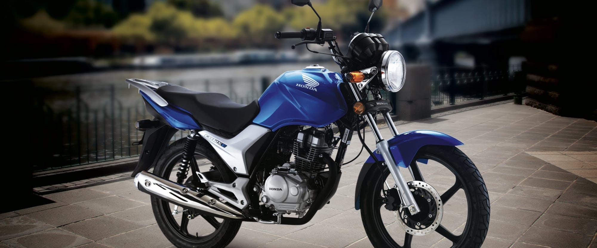 Honda CB125E in glint wave blue metallic colour, parked