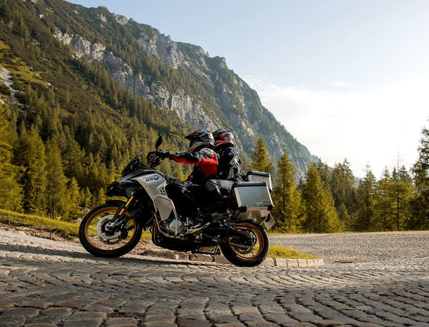BMW F 850 GS ADVENTURE RALLYE being ridden on a hill road with a passenger