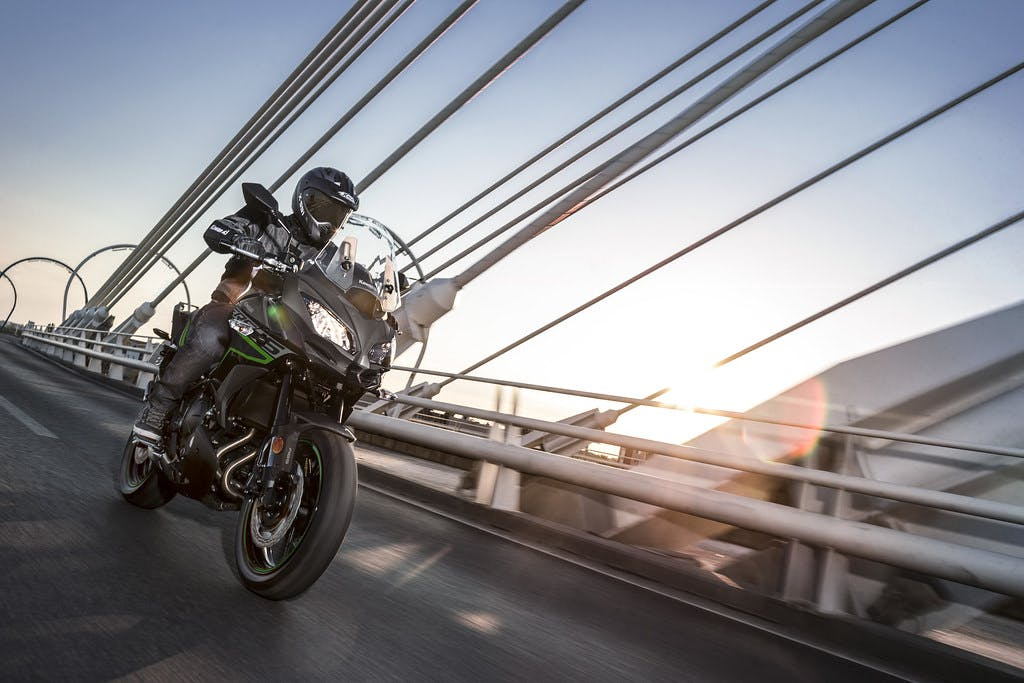 KAWASAKI VERSYS 650L in metallic flat spark black and metallic carbon grey colour on a highway