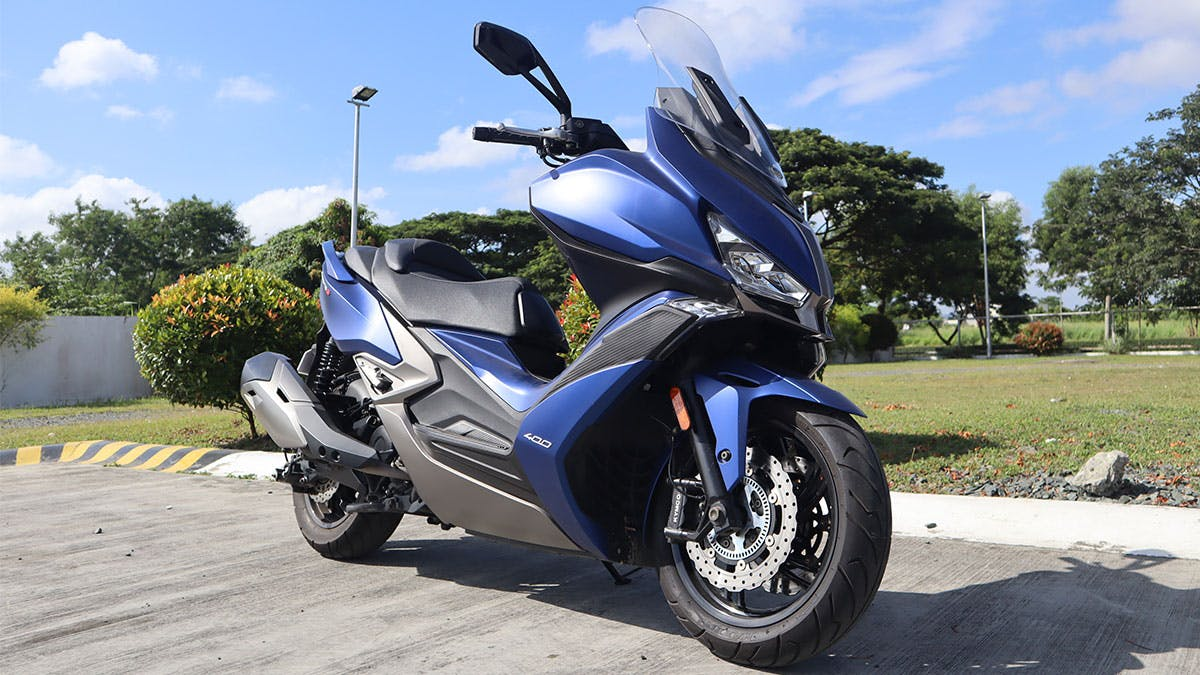 Kymco Xciting S 400i in blue colour, parked