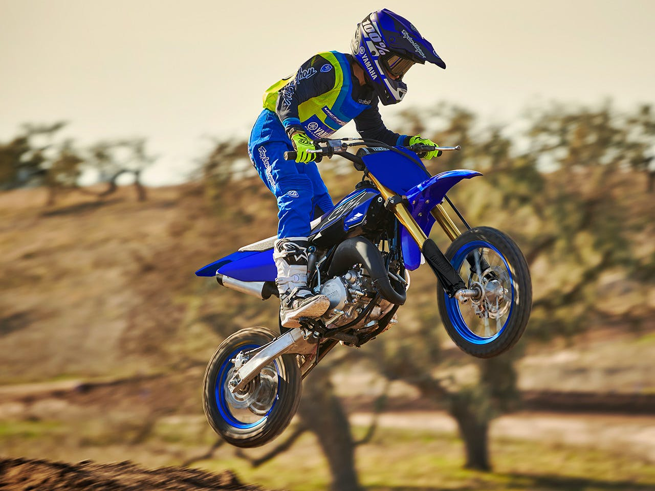 Yamaha YZ65 in team yamaha blue colour , being ridden off-track
