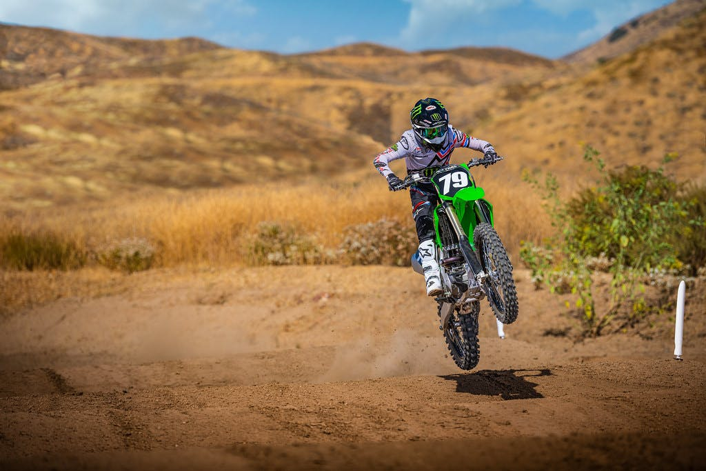 KawasakiI KX250 in lime green colour on off-road track